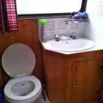 The toilet-bathroom is closing the corridor
